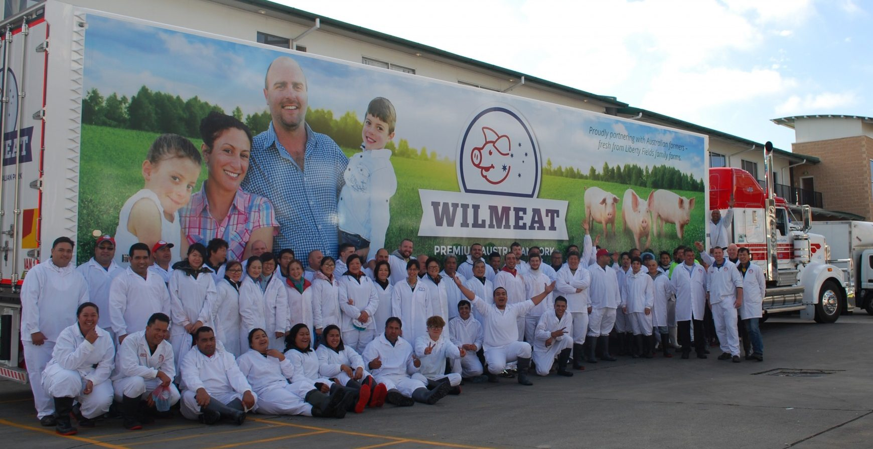 Wilmeat refrigerated truck with staff in front